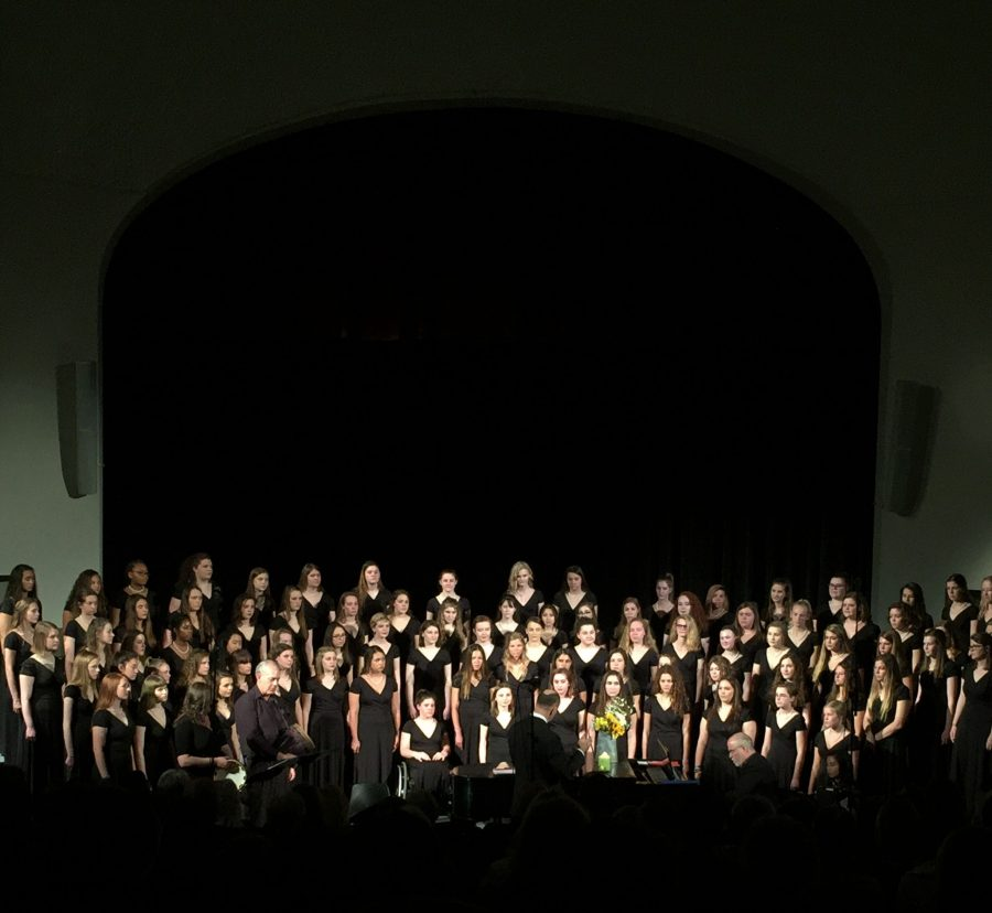 The+STA+choir+puts+on+their+annual+Spring+Concert+Mar.+21.+During+the+final+two+songs%2C+all+three+choirs+combined%2C+accompanied+first+by+Larry+Figg+on+cello+and+then+by+Samantha+Wagner+on+accordian%2C+Kent+Raush+on+djembe%2C+Diana+Edwin+on+tambourine+and+STA+Staff+Accompanist+Robert+Pherigo+on+piano.+photo+by+Gabby+Staker