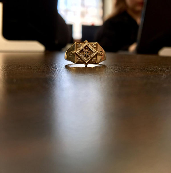 A+class+ring+sits+on+a+table+in+a+classroom.+Sophomores+got+their+fingers+sized+for+their+class+rings+during+class+meetings+April+6.+photo+by+Anne+Claire+Tangen