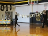 "Principal of academic affairs Barb McCormick, left, and principal of student affairs Liz Baker walk onto the Goppert Center Gymnasium floor with a ""Happy Birthday"" banner. As a way of commemorating STA's 150th anniversary, administration held a small assembly. photo by Kat Mediavilla"
