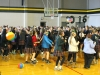 STA students flood the gym floor to dance during an assembly Jan. 4 to commemorate STA's 150th anniversary. photo by Kat Mediavilla