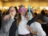 Seniors Alex Mullins, from left, Claire Jefferson and Mary Hilliard embrace one another while dancing. Students celebrated STA's 150th anniversary with 2016 glasses, headbands and a dance party. photo by Kat Mediavilla