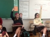Juniors Meghan Schmidt, left, and Jaclynn Sparks rise their hand during their AP Language class. photo by Paige Powell