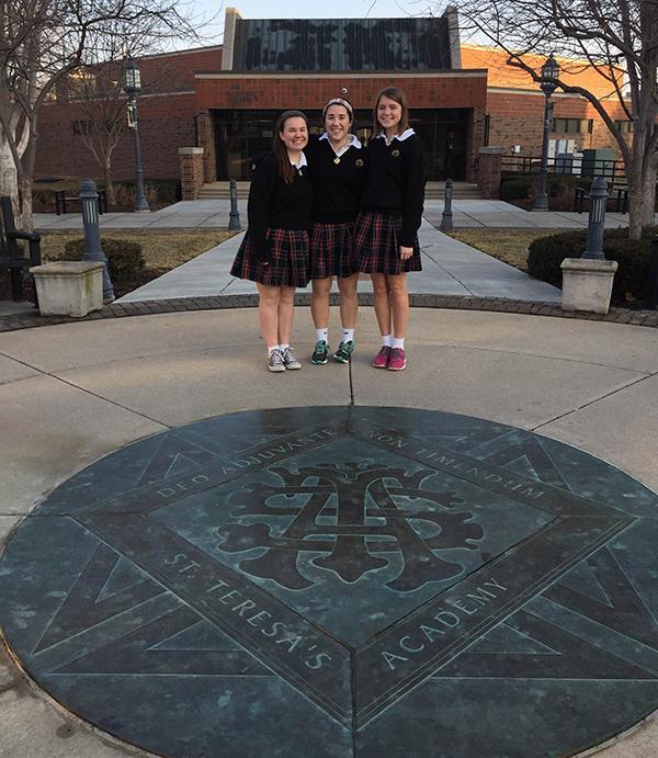 Seniors from left, Kat Mediavilla, Hallie Ryan and Maddy Medina pose on the seal at St. Teresa\'s Academy. photo by Bridget Jones.