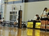 The Sion and STA varsity volleyball teams talk in huddles during a game in Goppert Sept. 16. photo by Maddy Medina