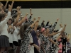 Sion students, dressed as cows, cheer at the STA vs. Sion varsity volleyball game in Goppert Sept. 16. photo by Maddy Medina