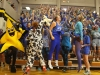 STA's student section jumps and shouts during a time out during the STA vs. Sion volleyball game Sept. 16. STA students dressed in an