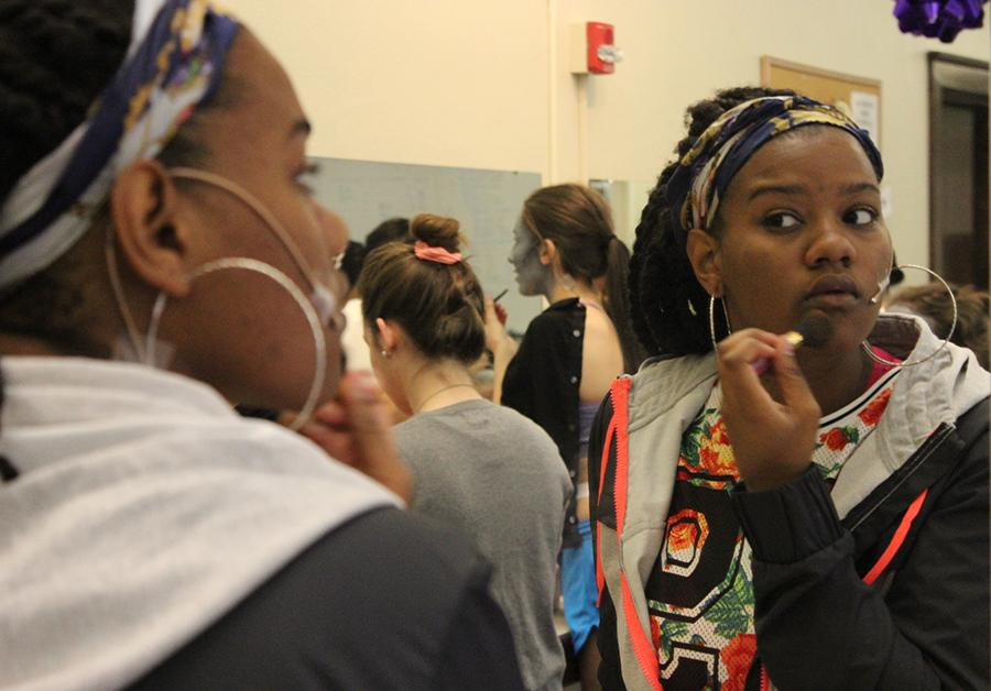 Junior Savaria Goodman applys makeup on opening night of Student Productions April 24. photo by Bridget Jones