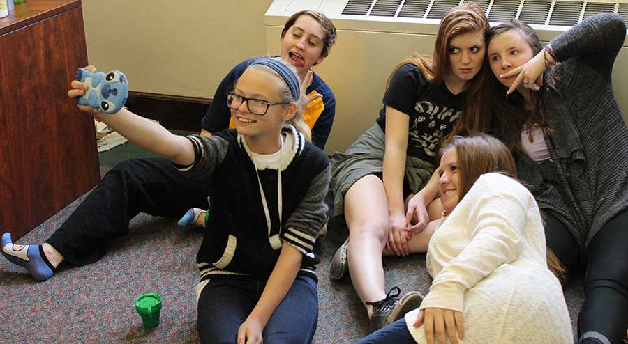Freshman Cassidy Shuster takes a selfie with other memebrs of crew for Student Productions April 24. photo by Bridget Jones