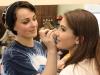 Sophomore Emma Gustavson, left, applies makeup to freshman Katelyne Kratofil for Student Productions April 24. photo by Bridget Jones