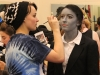 Sophomore Emma Gustavson, left, does junior Maggie Knox's eyebrows for Student Productions April 24. photo by Bridget Jones