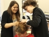 Senior Abby Elias, left, and junior Emma Jensen assist senior Madeline Meloy, middle, with her hair for Student Productions April 24. photo by Bridget Jones