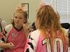 Freshman Katie Lecluse applies foundation for Student Productions April 24. photo by Bridget Jones