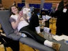 Senior Maggie O'Neil smiles while giving blood at STA's annual blood drive Friday in the Goppert Center. photo by Kate Scofield