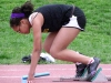 Freshman Victoria Richardson gets set for her leg of the 4x200 meter at Central Relays April 15. by Kennedy Bright