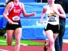 Senior Courtney Coppinger pulls away from Maize High School's Sydney Roy in the final stretch during the second leg of the 4x800m relay at the Kansas Relay April 20. STA finished second out of 40 schools competing. by Kennedy Bright