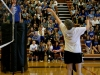 Dr. Liz Baker tips the ball over the net in the annual Saint Teresa's building wars volleyball game. The game took place Thursday October 8th in the gym, and is sponsored by the Student Community Organization. photo by Kate Scofield