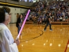 Kathleen Barry of the Donnelly team watches on at the annual building wars volleyball game. Both Donnelly and M&A teams were dressed in the theme of Star Wars. photo by Kate Scofield