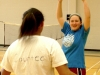 Freshman Elizabeth Countee, left, congratulates badminton teammate Sophia Cusumano as she celebrates the pair'€™s victory during their PE class on April 15. Freshmen started badminton tournaments in their gym classes, while PE teacher Stacie O'Rear invited all grades to play during activity periods. by Casey Campo