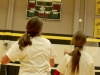 Freshman Clare Cain, left, and badminton teammate Ellie Petree wait for the birdie to fall during their PE class on April 17. Freshmen started badminton tournaments in gym classes, while PE teacher Stacie O'Rear invited all grades to play during activity periods. by Casey Campo