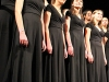 The STA Singers stand on the risers in between songs during their performance during activity period Jan. 27. The girls showcased their performance for the MMEA conference later that week. photo by Maggie Knox