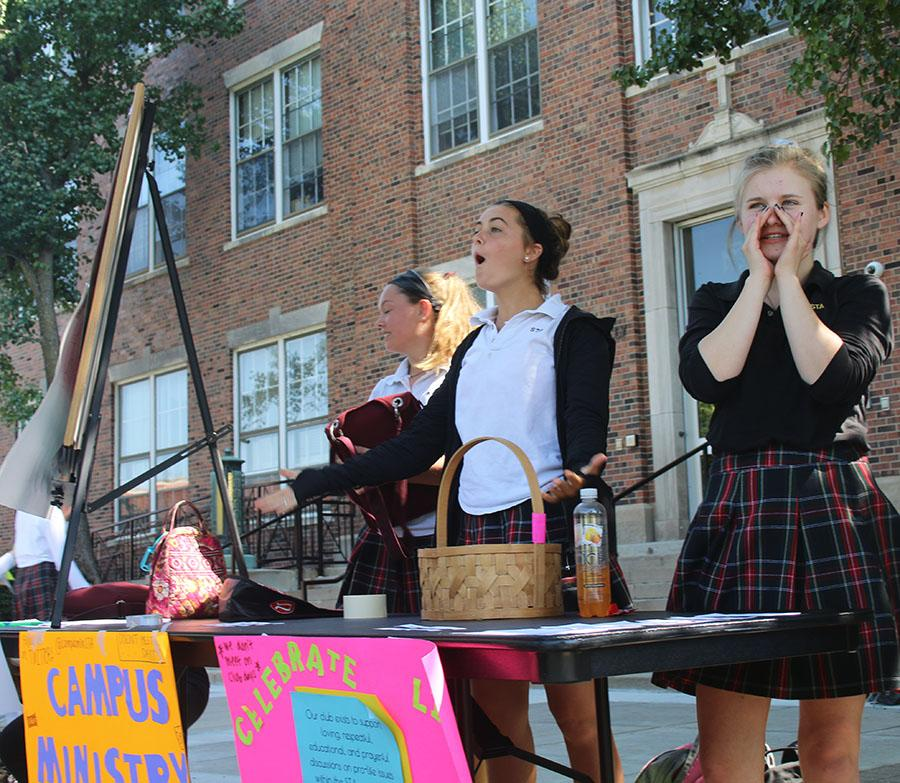 Junior Marin Brown encourages students to join Celebrate Life Club at the club fair Aug. 24. photo by Bridget Jones