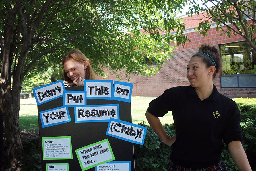 English teacher Kate Absher and junior Bailey Briscoe advertise the Don\'t Put This On Your Resume Club at the club fair Aug. 24. photo by Bridget Jones