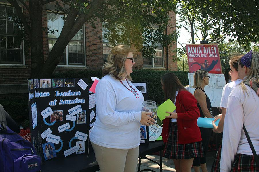 Social studies teacher Alicia Stewart tells students about Future Business Leaders of America, an extracurricular, at the club fair Aug. 24. photo by Bridget Jones