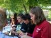 Senior Sadie Green works at the STEM Club table at the club fair Aug. 24. photo by Bridget Jones