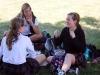 Seniors Katie Donaldson, Emma Jensen and Bella Meisel relax in the quad at the club fair Aug. 24. photo by Bridget Jones