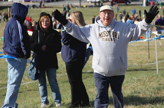 STA stubstitute teacher Ed Chronister celebrates after STA places second at the varsity cross country Sectionals race. Photo by Celia O'Flaherty