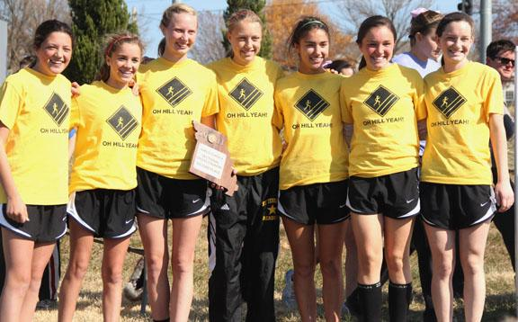 Cross country runners Hayden Lee, left, Ann Campbell, Courtney Coppinger, Lane Maguire, Kelly O'Byrne, Sarah Vickory and Katie Hornbeck pose for a picture after receiving the second place trophy at the varsity cross country Sectionals meet. The team will advance to State.  Photo by Celia O'Flaherty