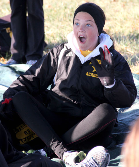 Freshman Hayden Lee tells a story to her varsity cross country teammates before the Sectionals meet Saturday, Oct. 29.  Lee placed 24th and STA placed second overall. Photo by Celia O\'Flaherty