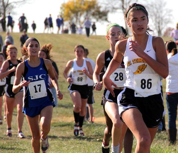 Senior Kelly O\'Byrne runs in the varsity cross country Sectionals Saturday, Oct. 29.  O\'Byrne placed 35th in the race and STA placed second overall. Photo by Celia O\'Flaherty
