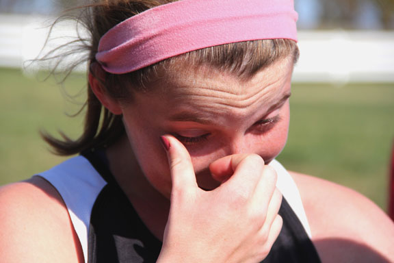 Senior Lane Schulte cries as she realizes she had just run her last cross country meet at Sectionals Saturday, Oct. 29. Schulte placed 64th at the race. Photo by Celia O'Flaherty