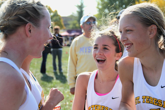 Junior Courtney Coppinger, left, tells a joke to freshman Ann Campbell and junior Lane Maguire after the varsity cross country Sectionals race. STA placed second overall and will advance to State. Photo by Celia O'Flaherty