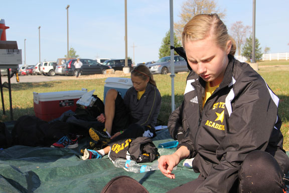 Juniors Courtney Coppinger, foreground, and Lane Maguire prepare for the sectional meet last Saturday. Photo by Allison Fitts