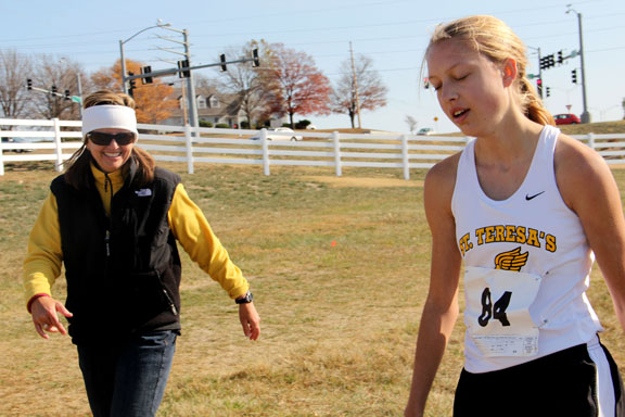 Lane Maguire, right, and her mother Lucie Maguire walk back to the tent after the sectional race. Photo by Allison Fitts