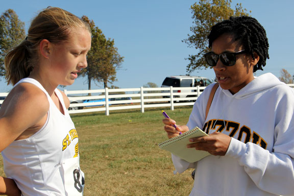 Junior Lane Maguire, left, is interviewed by Kansas City Star newspaper reporter Candace Buckner. An article quoting Maguire was featured in the Kansas City Star on Oct. 30. Photo by Allison Fitts