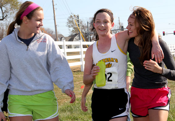 Sophomores Maggie Herrington, Katie Hornbeck and Cecilia Butler walk back to the tent after the sectional race on Saturday. Photo by Allison Fitts