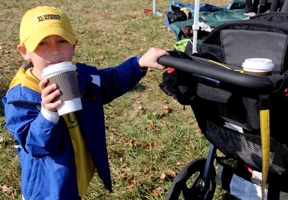 Head cross country coach Karen Moran\'s son, Michael, hangs out at the STA tent following the sectional race. Photo by Allison Fitts