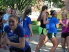 The Twinkie baton is passed from runner to runner as the annual cross country Twinkie relay enters the second leg. The relay is a tradition started by Coach Mike Egner where the team is split into small realy groups and given a Twinkie to use as a baton. photo by Libby Hutchison