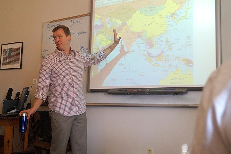 Mr. Himes, an English Teacher at St. Teresa\'s, teaches one of his classes about the landscape of India prior to reading Nectar in a Sieve. photo by Vioelt Cowdin