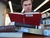 Rockhurst Senior, Trey Hunt, reads A Farewell to Arms by Ernest Hemmingway at the Plaza Library. photo by Violet Cowdin
