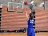 Junior Natalie Kistler shoots a freethrow to warm up for her team's first CYO basketball practice Nov. 30 in the Goppert Center. The team practiced in preparation for their first game Saturday, Dec. 3.  photo by Sophie Sakoulas