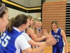 Junior Maeve Madden goes through a line of her teammates, high-fiving each one at her team's first CYO basketball practice Nov. 30 in the Goppert Center. Madden won a game of knockout and her teammates helped her celebrate her win. photo by Sophie Sakoulas