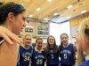 Juniors Natalie Kistler ,left, and Emily Livingston, right, give a pep talk to their CYO team in a huddle before their practice. The team's jersey represented the school their team is run through, St. Peters Catholic School. photo by Sophie Sakoulas