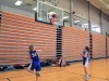 Junior Zoe Butler, right, shoots the basketball as junior Grace Laid, right, anticipates the rebound at their CYO team's first practice Nov. 30 in the Goppert Center. Butler and Laird participated in a 1-1 drill.  photo by Sophie Sakoulas