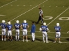 Members of the Rockhurst High School football team stand on the sidelines at a game held at Rockhurst Oct. 14. The STA dance team performed at half time, their annual performance for Rockhurst. photo by Cassie Hayes