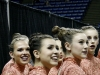 Members of the STA dance team gaze to the crowd and smile at family and friends who came to watch their performances at the state competition Feb. 20. photo by Anna Hafner