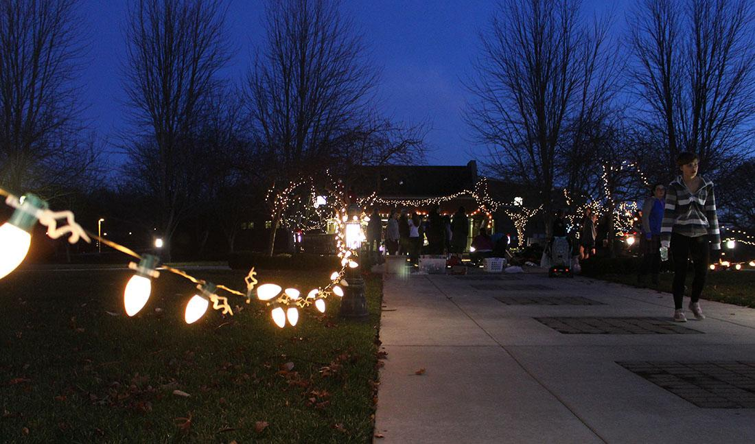 Christmas lights shine bright on the St. Teresa's Academy campus. Students from the class of 2016 gathered before school Wednesday Dec. 9 in memory of STA alumna Becca Lueke. photo by Kat Mediavilla